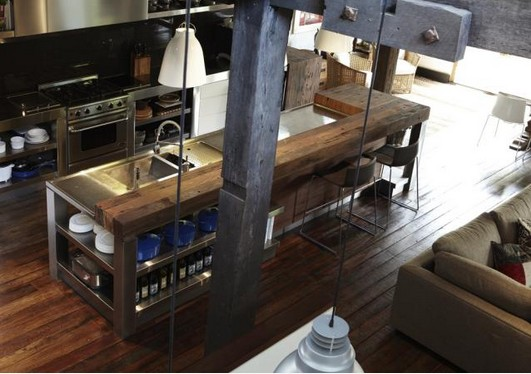 Wooden flooring, wooden countertop to soften stainless steel and concrete for industrial kitchen look
