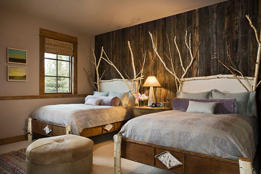 Birch wood branches and reclaimed wood wall for a comfy and rustic bedroom