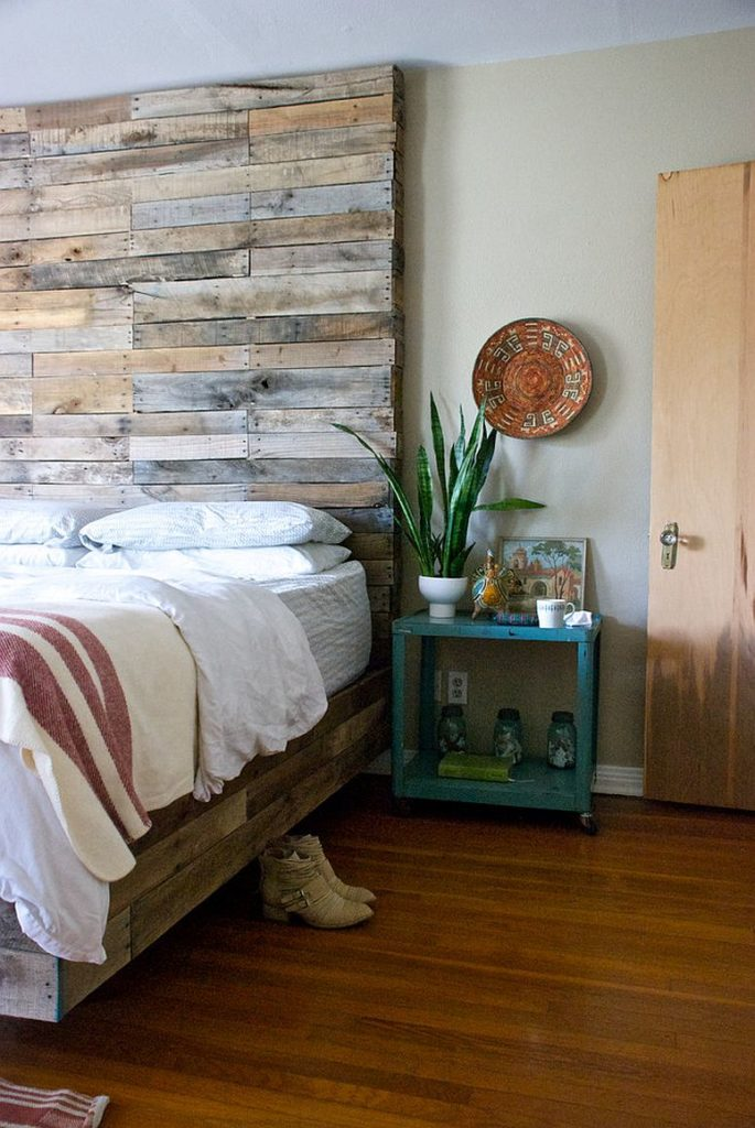 Creative reclaimed wood full height headboard for a contemporary bedroom design