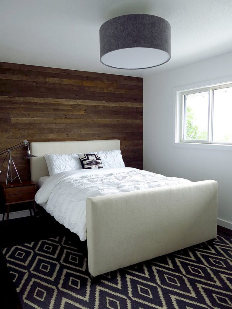 Works just as well in short rooms. Reclaimed wood feature wall adds charm to any bedroom from small to big
