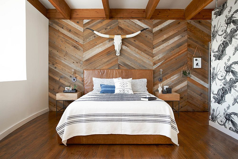 Reclaimed wood wall with chevron pattern on the wall behind the bed