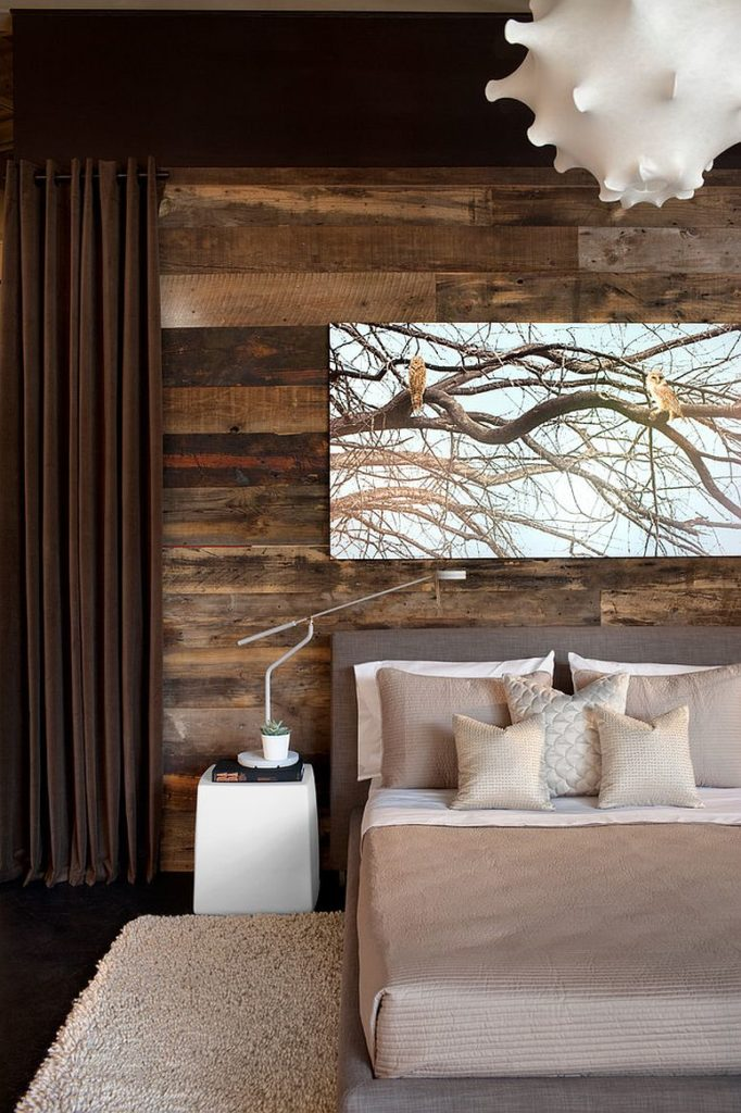 Rustic design with the use of reclaimed wood horizontally lined in the contemporary styled bedroom with big photo on canvas