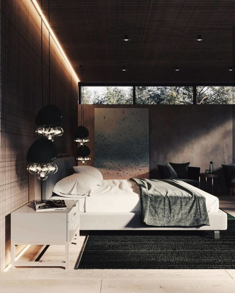 Strip wood accent in a dark modern bedroom with bulbous pendant lights above bedside tables