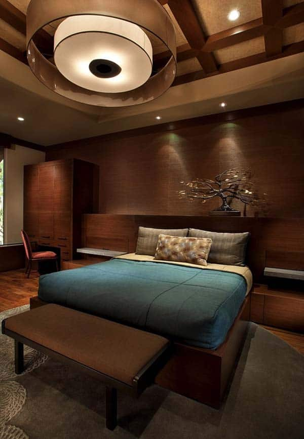 All round wood clad bedroom walls with soft lighting
