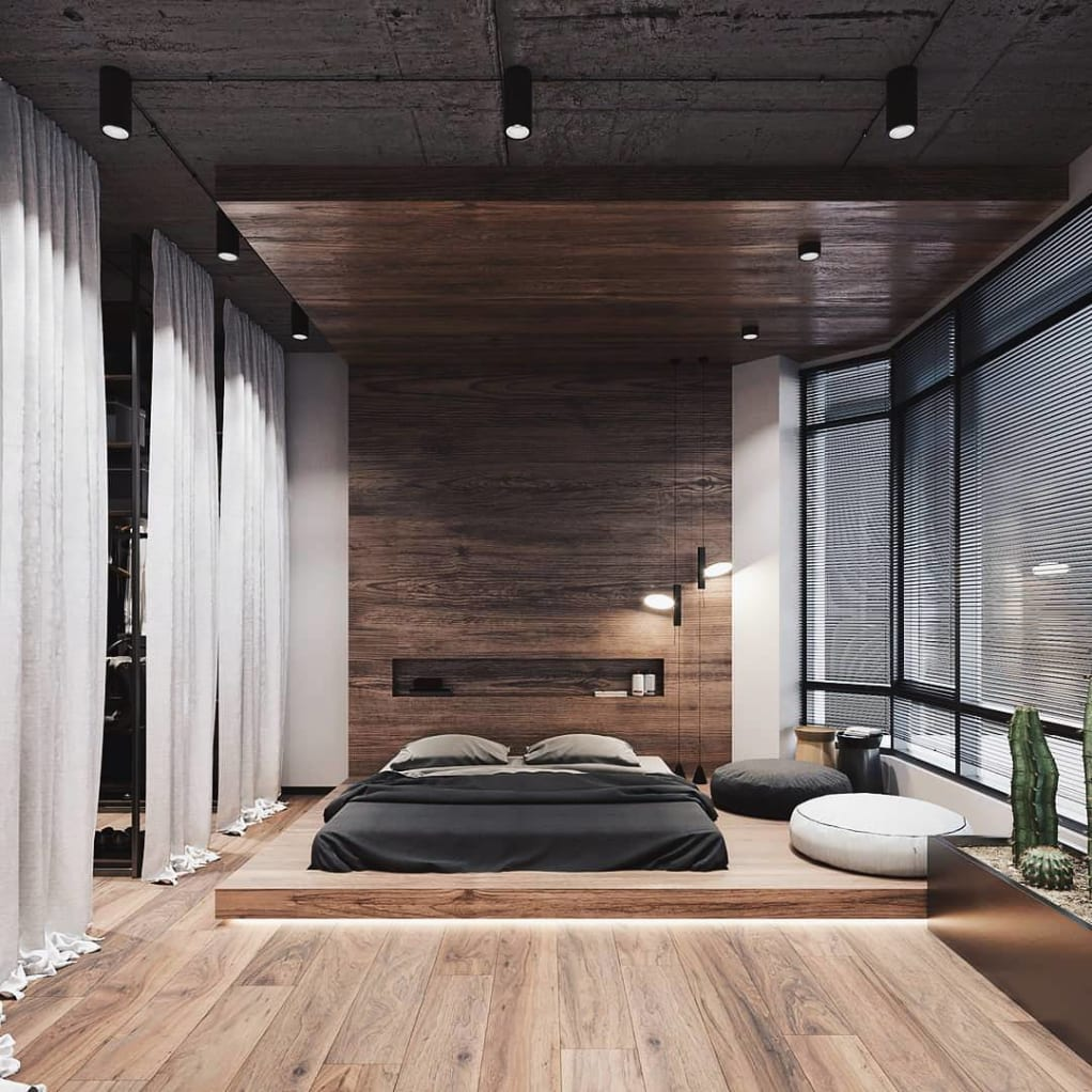 City Pad with wooden feature wall in bedroom with low raised bed on raised platform