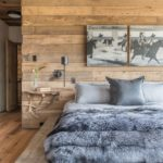 Mix of rustic and modern, with reused wood and a charming modern bedside table